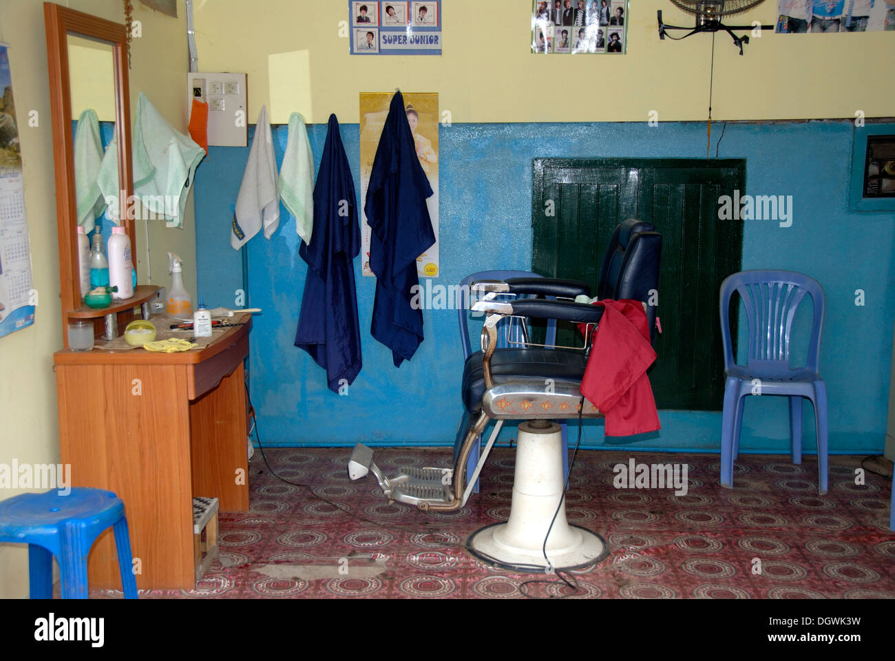 Interior, old hairdresser, hairdressing, hairdresser's chair, Vientiane, Laos, Southeast Asia, Asia - Stock Image
