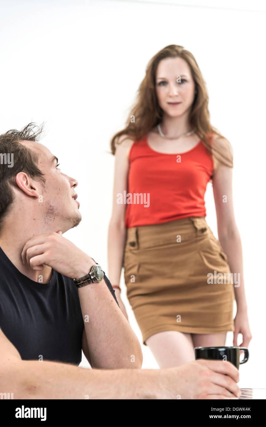 Man turning towards a woman, symbolic image for temptation - Stock Image