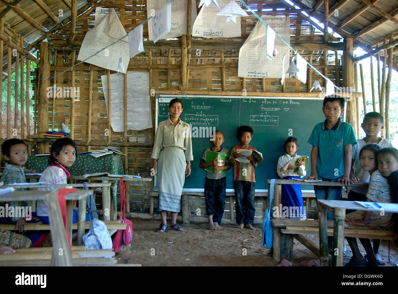 Poverty, teacher with a class in school, in front of a blackboard, primary school, pupils of the Khmu ethnic group - Stock Image