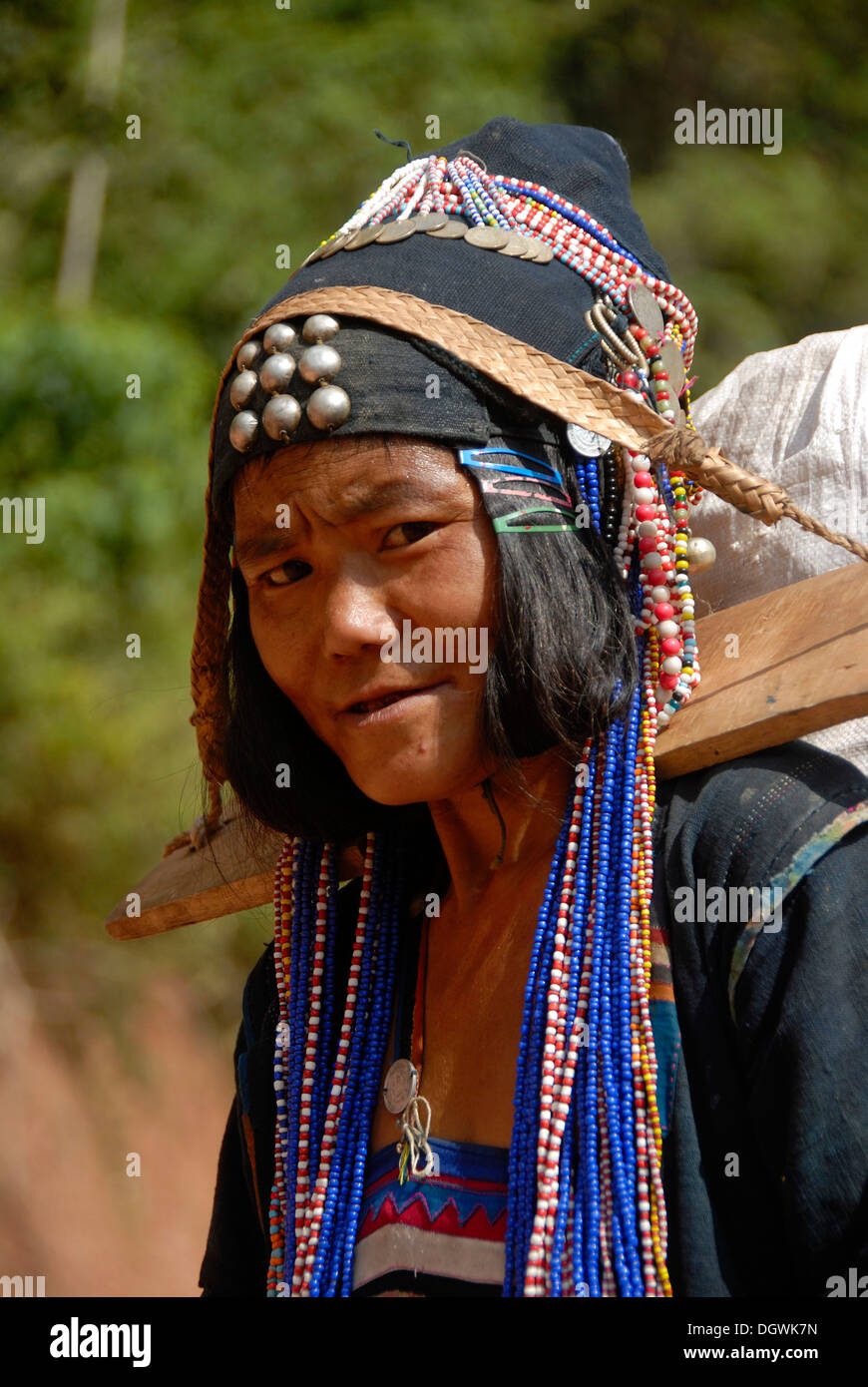 Poverty, ethnology, portrait, woman of the Akha Djepia ethnic group, traditional colorful clothes with indigo, headgear, Stock Photo