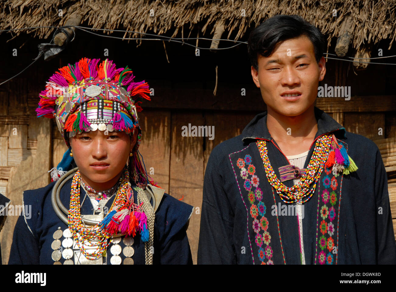 Portrait, woman and man of the Akha Loma ethnic group, colorful traditional clothing, traditional costume, Ban Noy - Stock Image