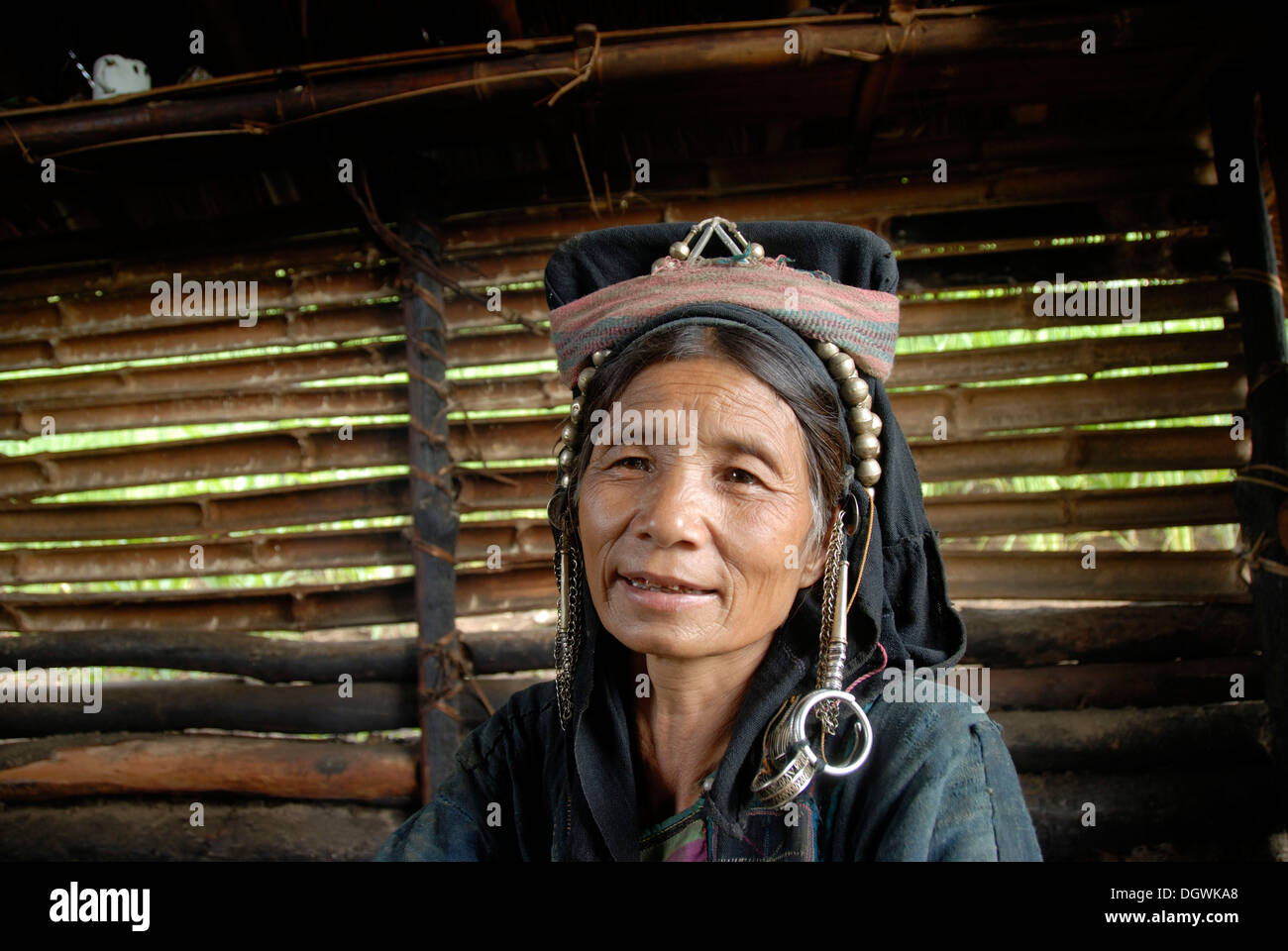 Poverty, ethnology, portrait, older woman of the Akha Nuqui ethnic group, traditional traditional costume, traditional Stock Photo