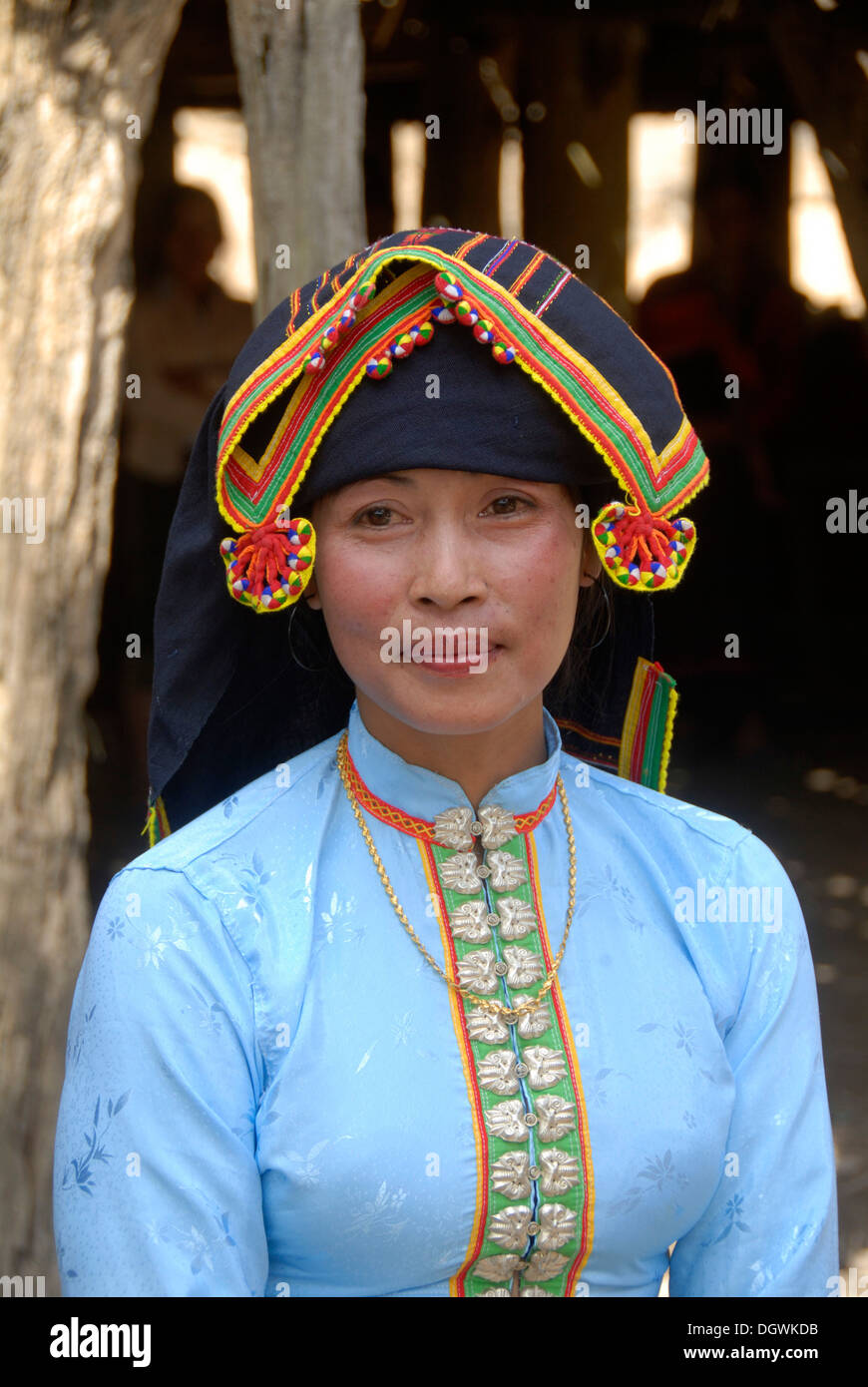 Portrait, woman of the Tai Dam, ethnicity, dress, traditional clothing, colorful embroidered headdress - Stock Image