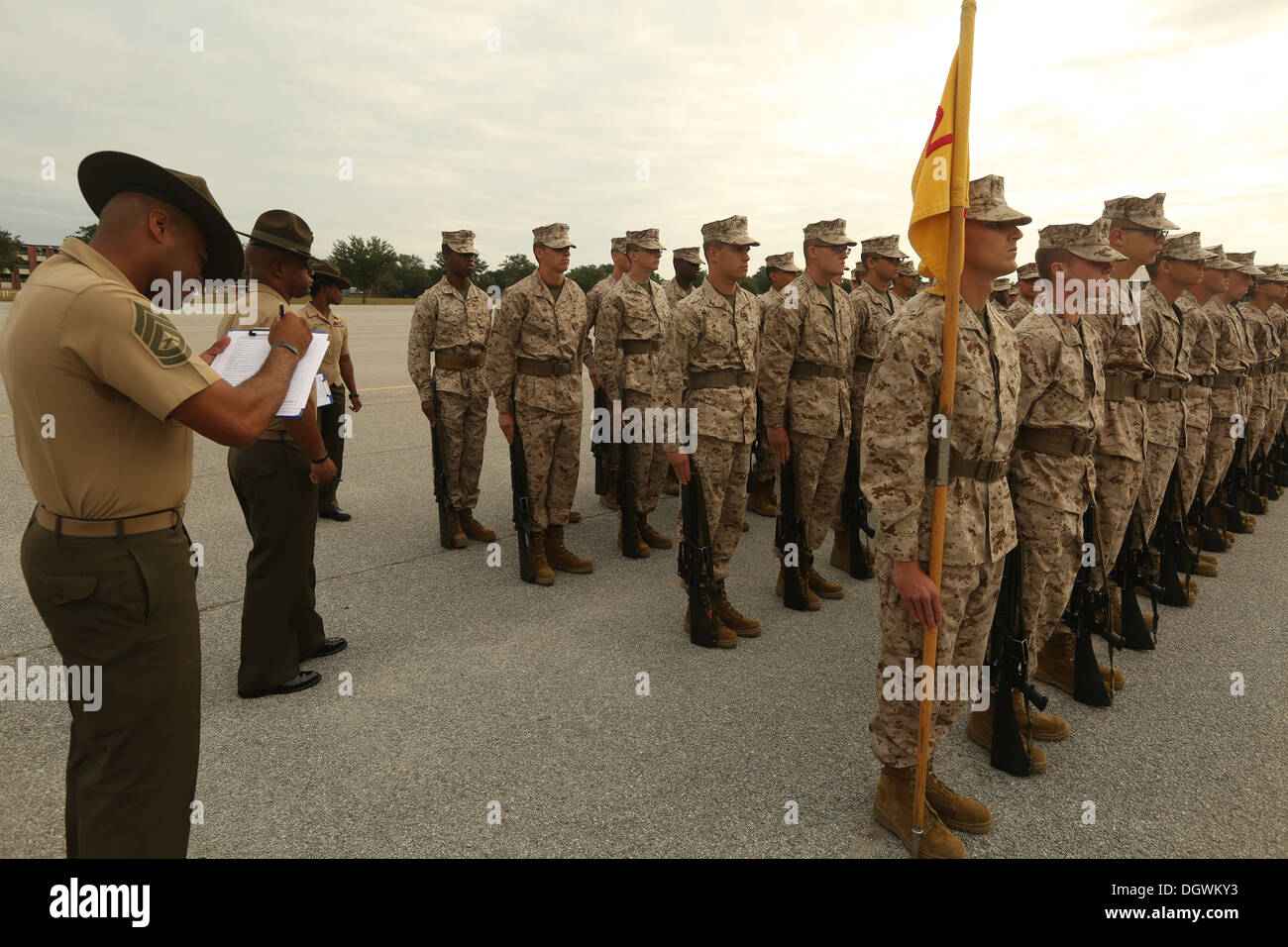Drillmasters, experts on the Marine Corps Drill and Ceremonies Manual,  grade recruits of Platoon 3102, Lima Company, 3rd Recruit