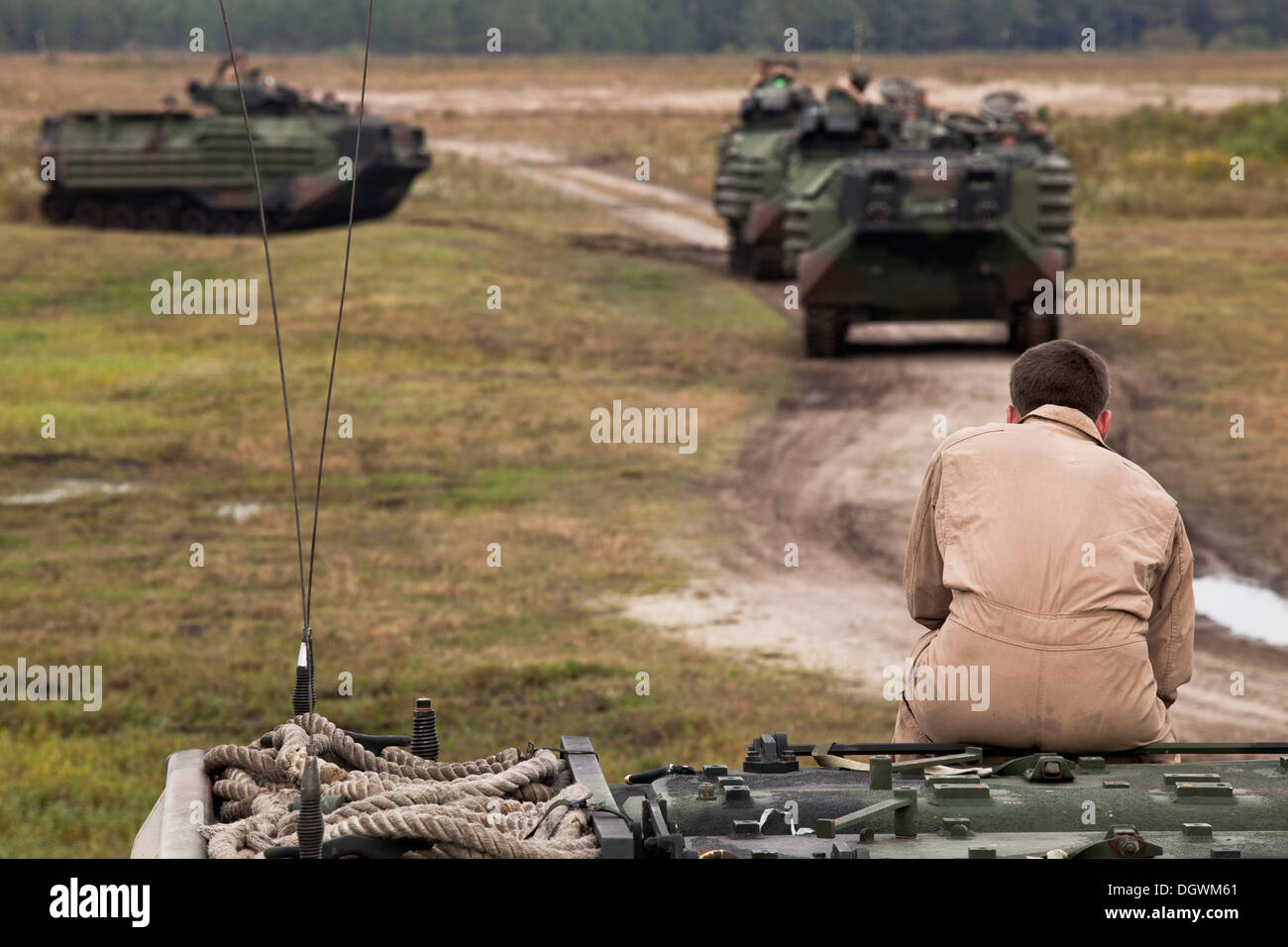 U.S. Marines with Bravo Company, 2nd Assault Amphibian Battalion, 2D Marine Division perform platoon size movements with AAV-7 Amphibious Assault Vehicles at Training Landing Zone Falcon aboard Camp Lejeune, N.C. Oct 18, 2013. Marines with Bravo Company p - Stock Image