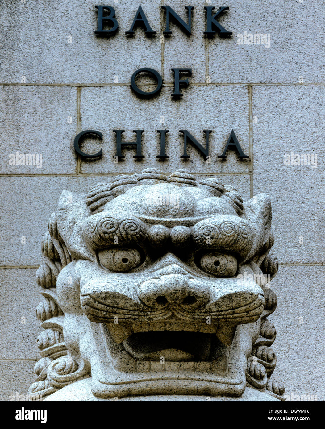 Lion sculpture in stone in front of the Bank of China, Central District, Victoria Island, Central District, Hong Kong - Stock Image