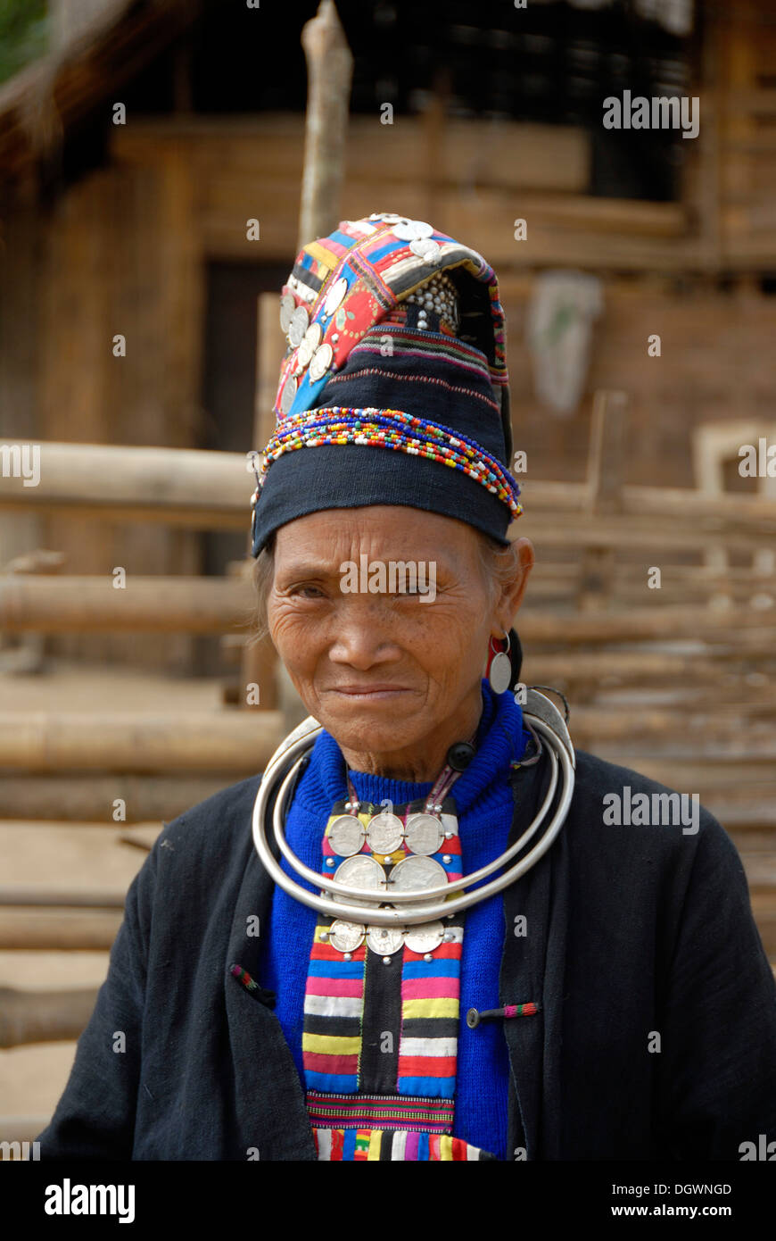 Portrait of old woman of the Akha Loma ethnic group, traditional black costume, colourfully embroidered, cap, silver Stock Photo
