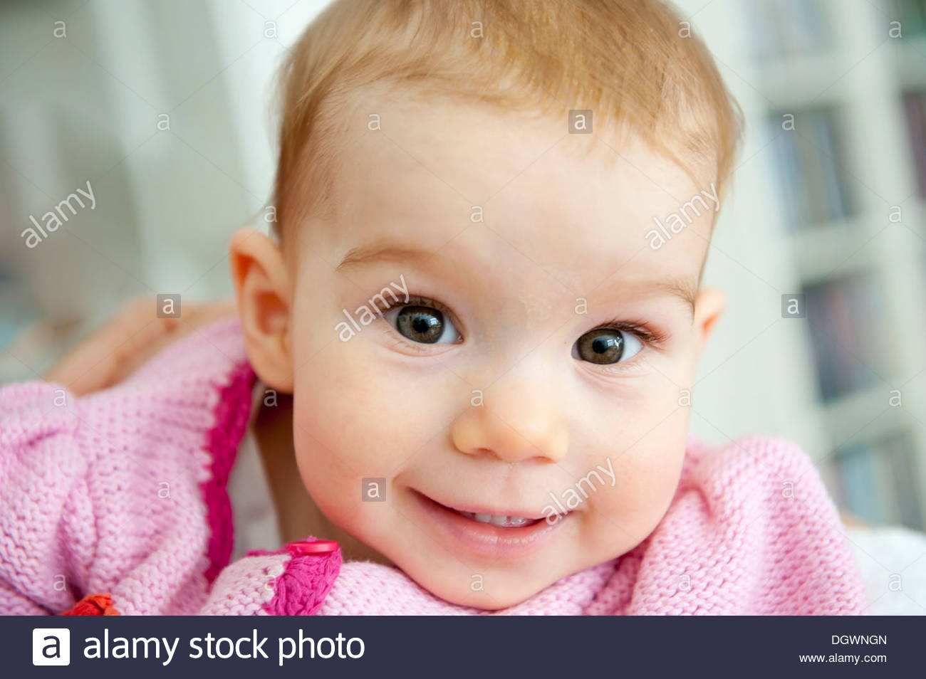 Wide eyed smiling toddler, girl, portrait, Munich, Bavaria - Stock Image
