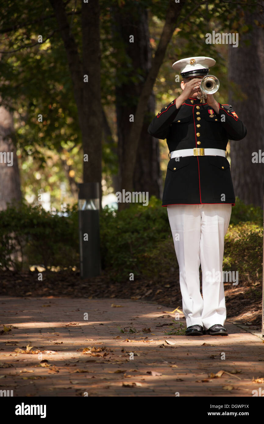 A member of the 2D Marine Division band plays Taps during the 30th anniversary memorial ceremony of the Beirut bombing in Jacksonville, N.C., Oct. 23, 2013. The city of Jacksonville holds a ceremony every year in honor and remembrance of those affected by - Stock Image