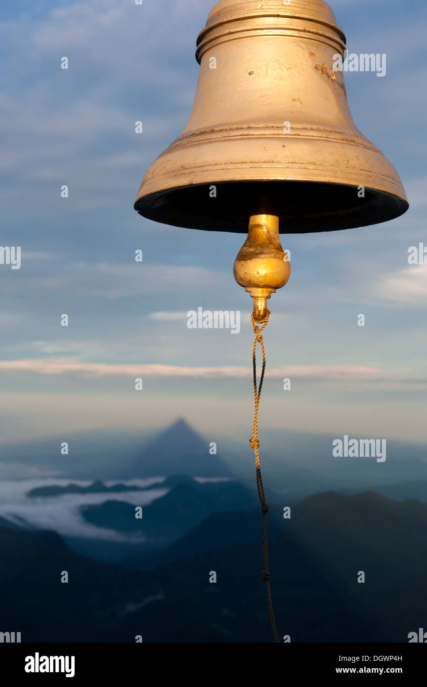 Bell, the shadow of the mountain at the back, the image of God, holy mountain, buddhist temple, Adam's Peak, Sri Pada, Dalhousie - Stock Image