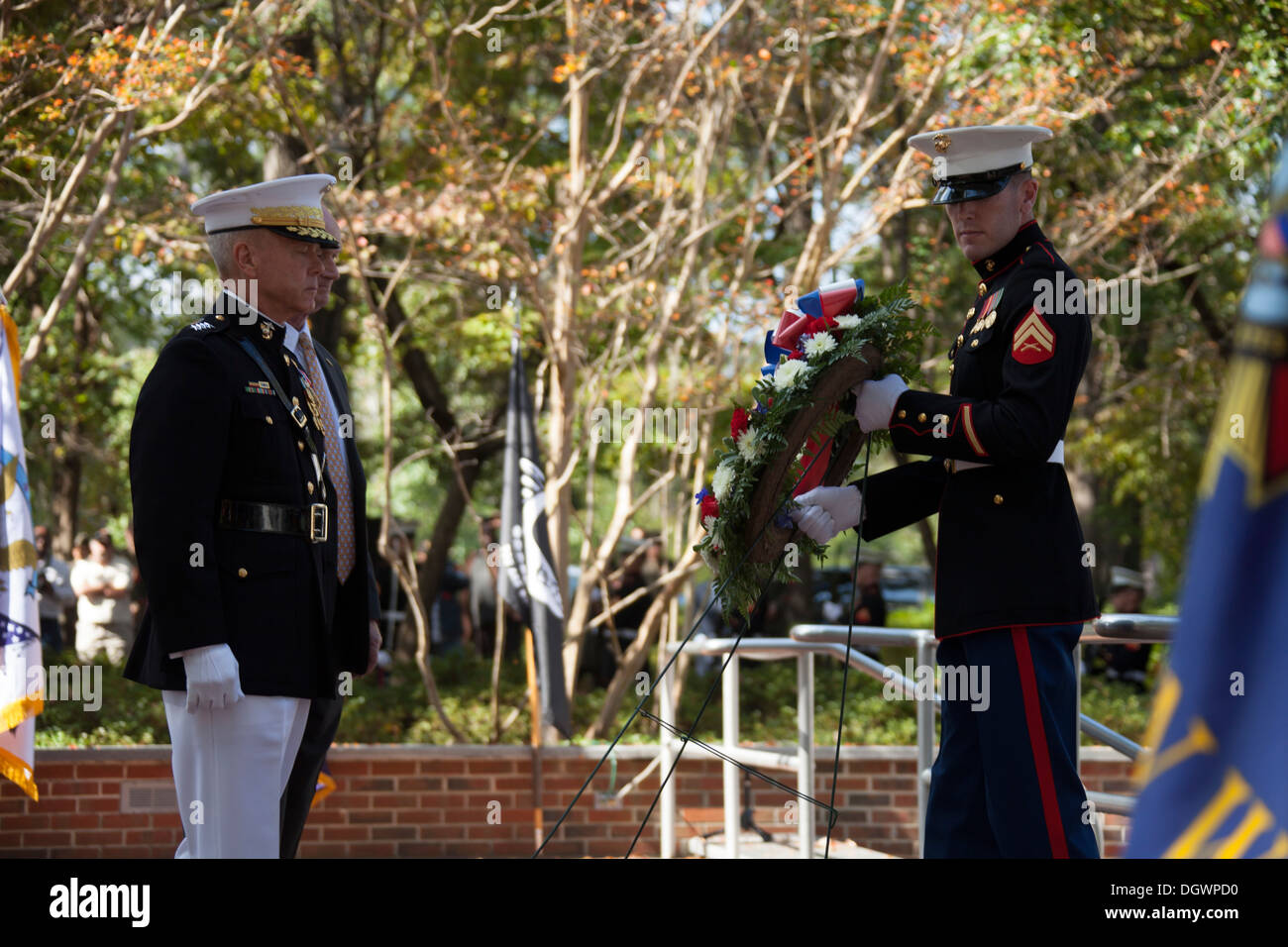 U.S. Marine Corps Gen. James F. Amos, left, 35th commandant of the Marine Corps, prepares to lay a wreath at the Stock Photo