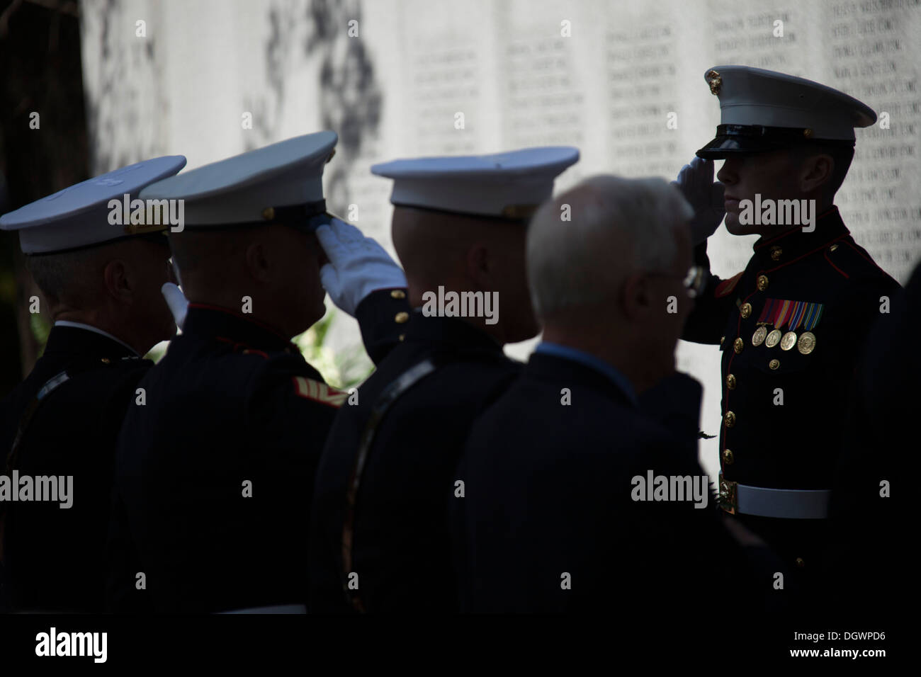 U.S. Marines, Sailors and civilians salute during an observance ceremony at the Beirut Memorial in Jacksonville, N.C., Oct. 23, - Stock Image