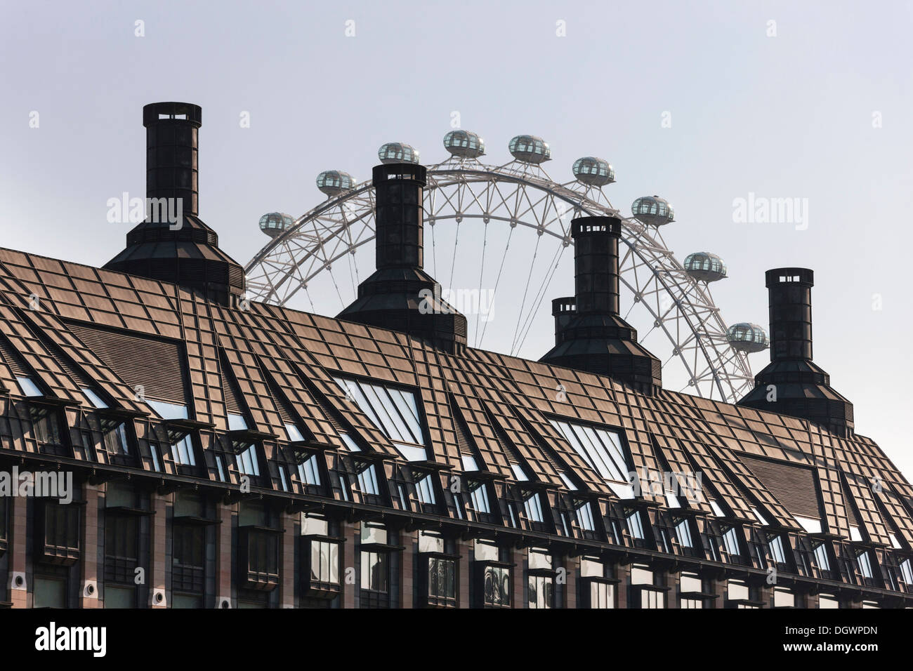 London Eye behind the roof of the Portcullis House, Westminster, London, England, United Kingdom, Europe - Stock Image