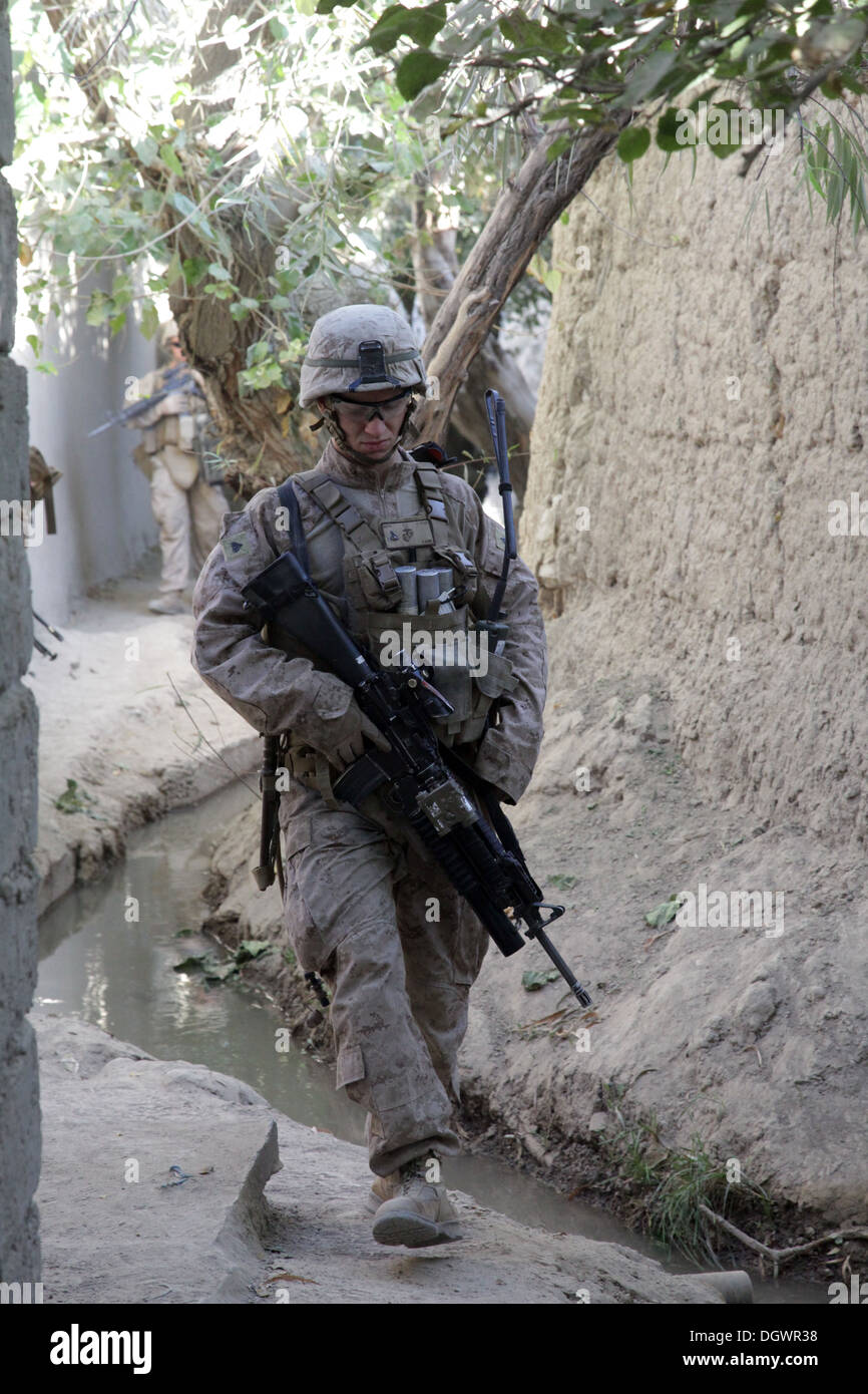U.S. Marine Corps Cpl. Elliot Kane, a team leader with India Company, 3rd Battalion, 7th Marine Regiment, patrols with his squad near Forward Operating Base Musa Qala, Helmand province, Afghanistan, Oct. 20, 2013. The Marines with 3/7 patrolled to reduce - Stock Image