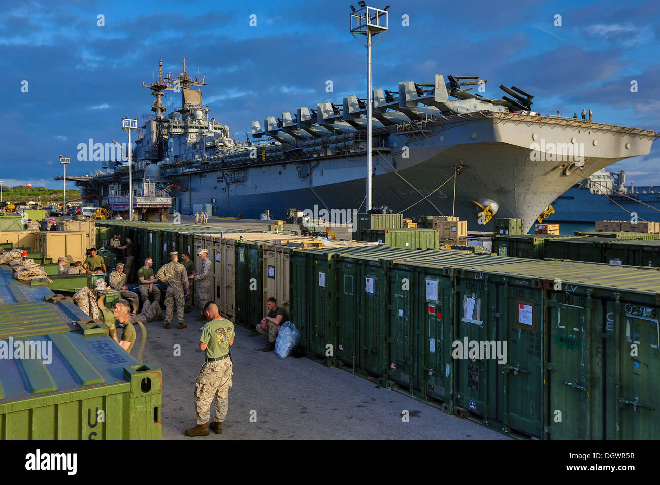 U.S. Marines and Sailors assigned to 26th Marine Expeditionary Unit (MEU) stand by to have their shipping containers inspected by U.S. Customs agents during the 26th MEU's wash down in Naval Station Rota, Spain, Oct. 19, 2013. The 26th MEU is a Marine Air - Stock Image