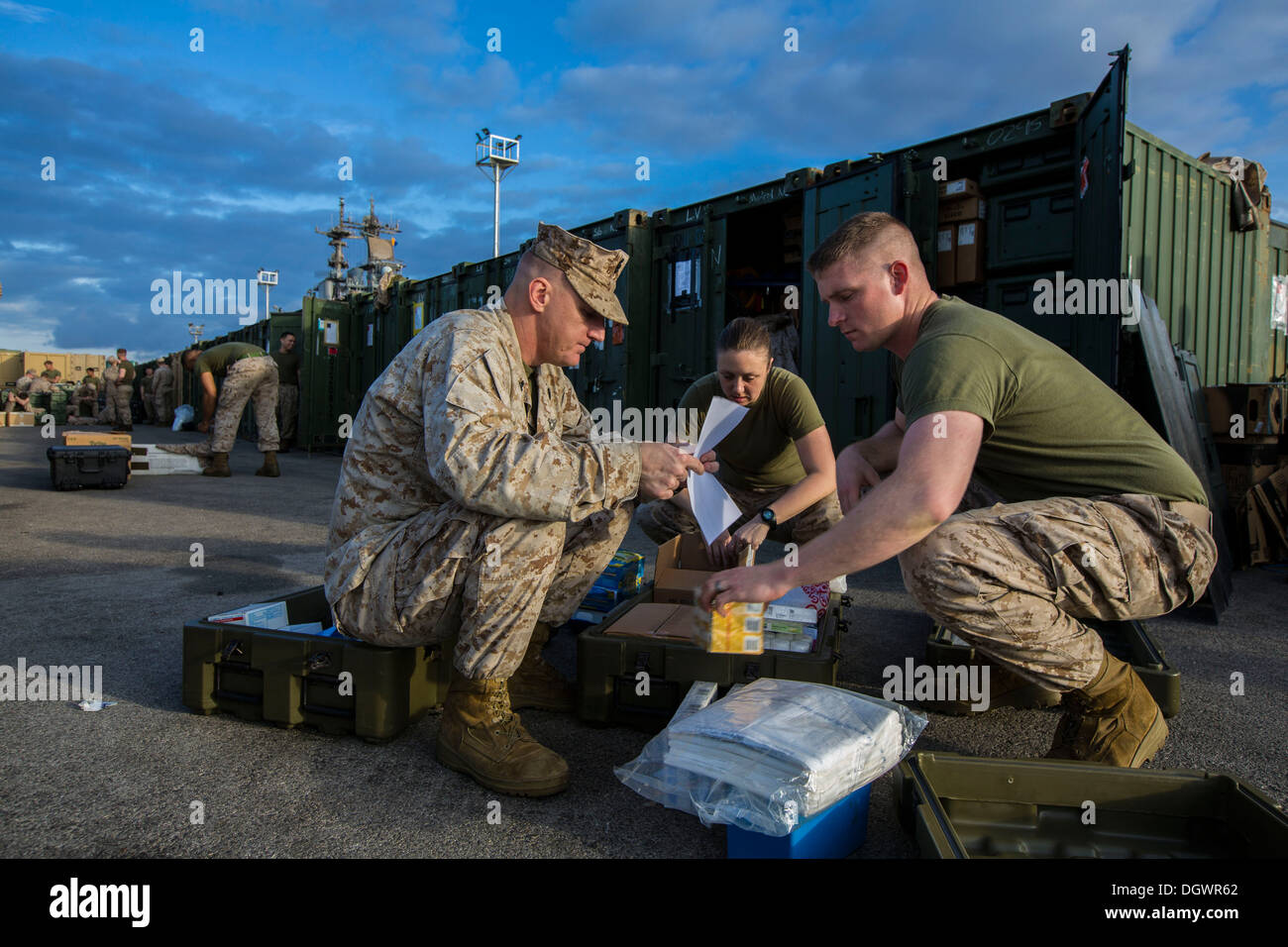 26th Marine Expeditionary Unit (MEU) medical personnel sort pharmaceutical supplies before having their shipping containers inspected by U.S. Customs agents during the 26th MEU's wash down in Naval Station Rota, Spain, Oct. 19, 2013. The 26th MEU is a Mar - Stock Image
