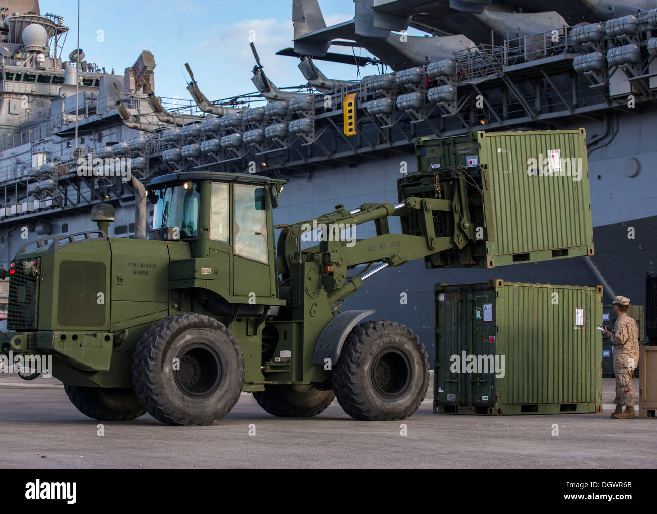 Shipping containers are stacked after being inspected by U.S. Customs agents during the 26th Marine Expeditionary Unit's (MEU) wash down in Naval Station Rota, Spain, Oct. 19, 2013. The 26th MEU is a Marine Air-Ground Task Force forward-deployed to the U. - Stock Image