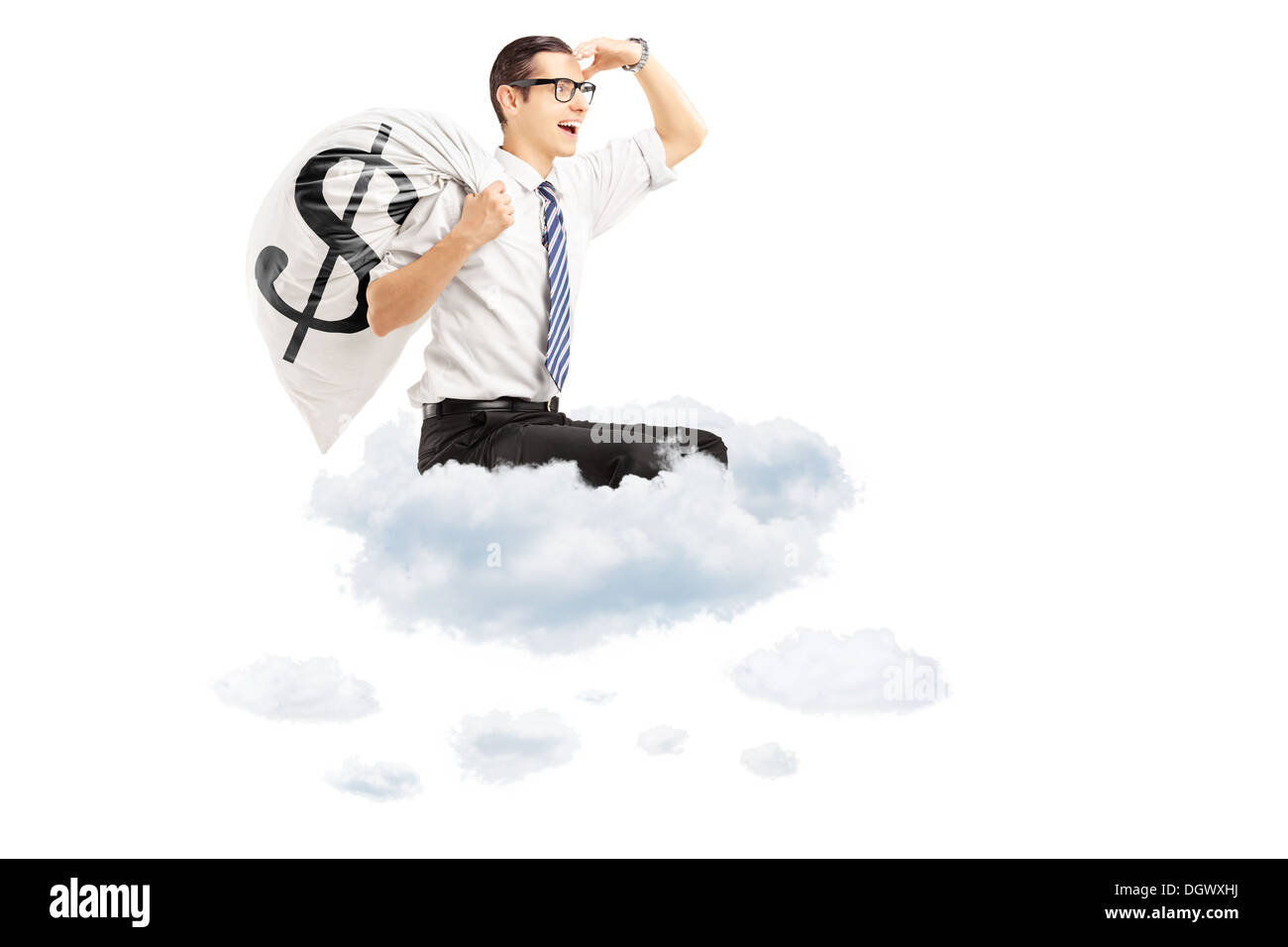 Young businessman with a money bag with US dollar sign flying on clouds - Stock Image
