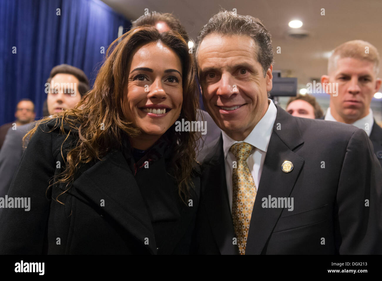 Albertson, New York, U.S. 26th October 2013. New York Governor ANDREW CUOMO, at right, poses for a photo after he endorses Suozzi for Nassau County Executive, with supporters, including veterans, union members, and Democratic candidates for office in Nassau and Suffoilk Counties in Long Island, filling the announcement room at the Albertson Veterans of Foreign Wars VFW Post. Democrat Suozzi, the former Nassau County Executive, and Republican encumbant Mangano face each other in a rematch in the upcoming November 5th election. © Ann E Parry/Alamy Live News - Stock Image