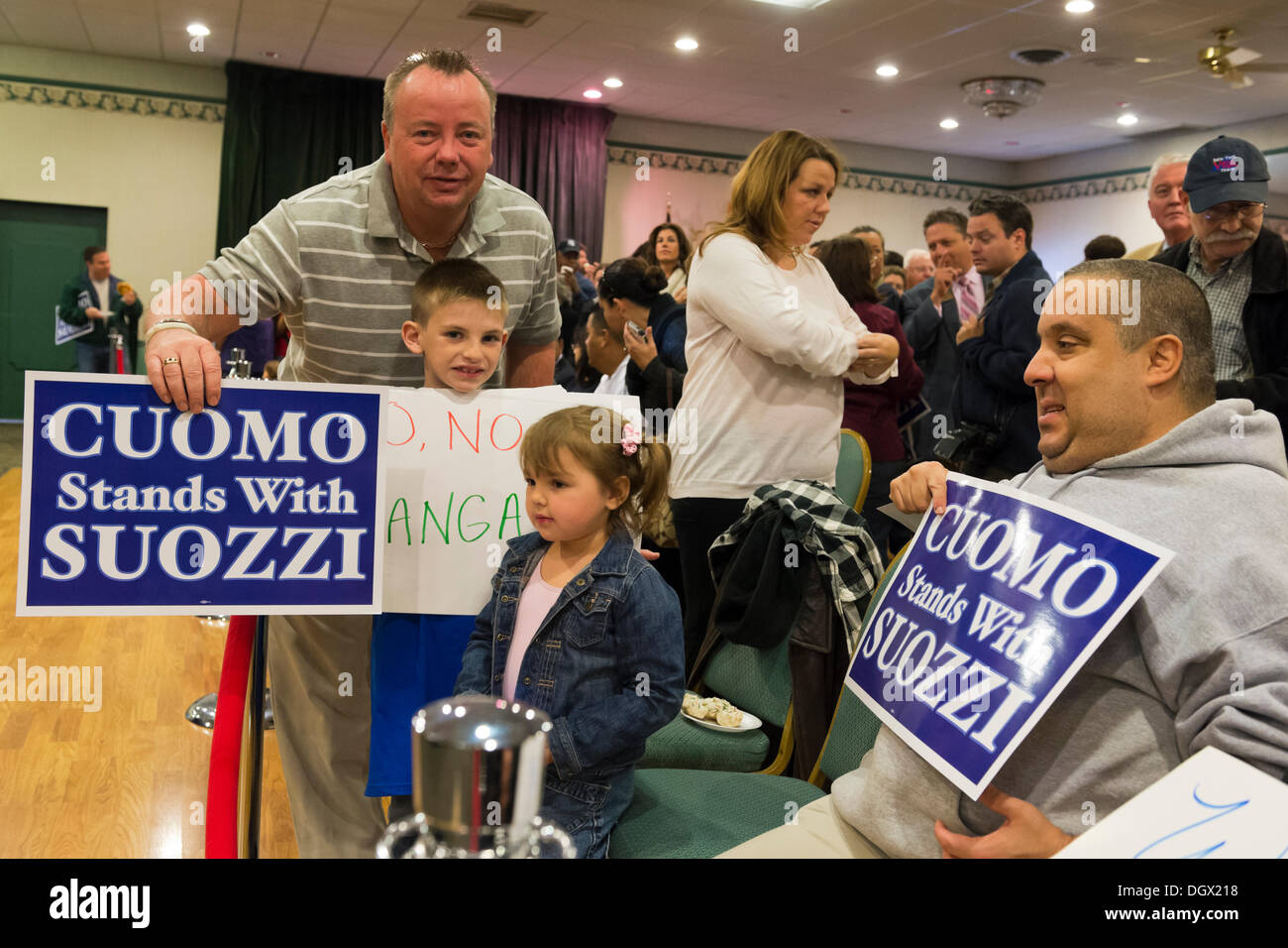 Albertson, New York, U.S. 26th October 2013. L-R, KEVIN DOOLIN and FINNEGAN CORCORAN-DOOLIN, 8, of Bellmore, RILEY GALANTA, 3, of Mineola, and RANDY KOVAR of Massapequa, are in the audience when New York Governor Cuomo endorses Suozzi for Nassau County Executive, at the Albertson Veterans of Foreign Wars VFW Post. Democrat Suozzi, the former Nassau County Executive, and Republican encumbant Mangano face each other in a rematch in the upcoming November 5th election. © Ann E Parry/Alamy Live News - Stock Image