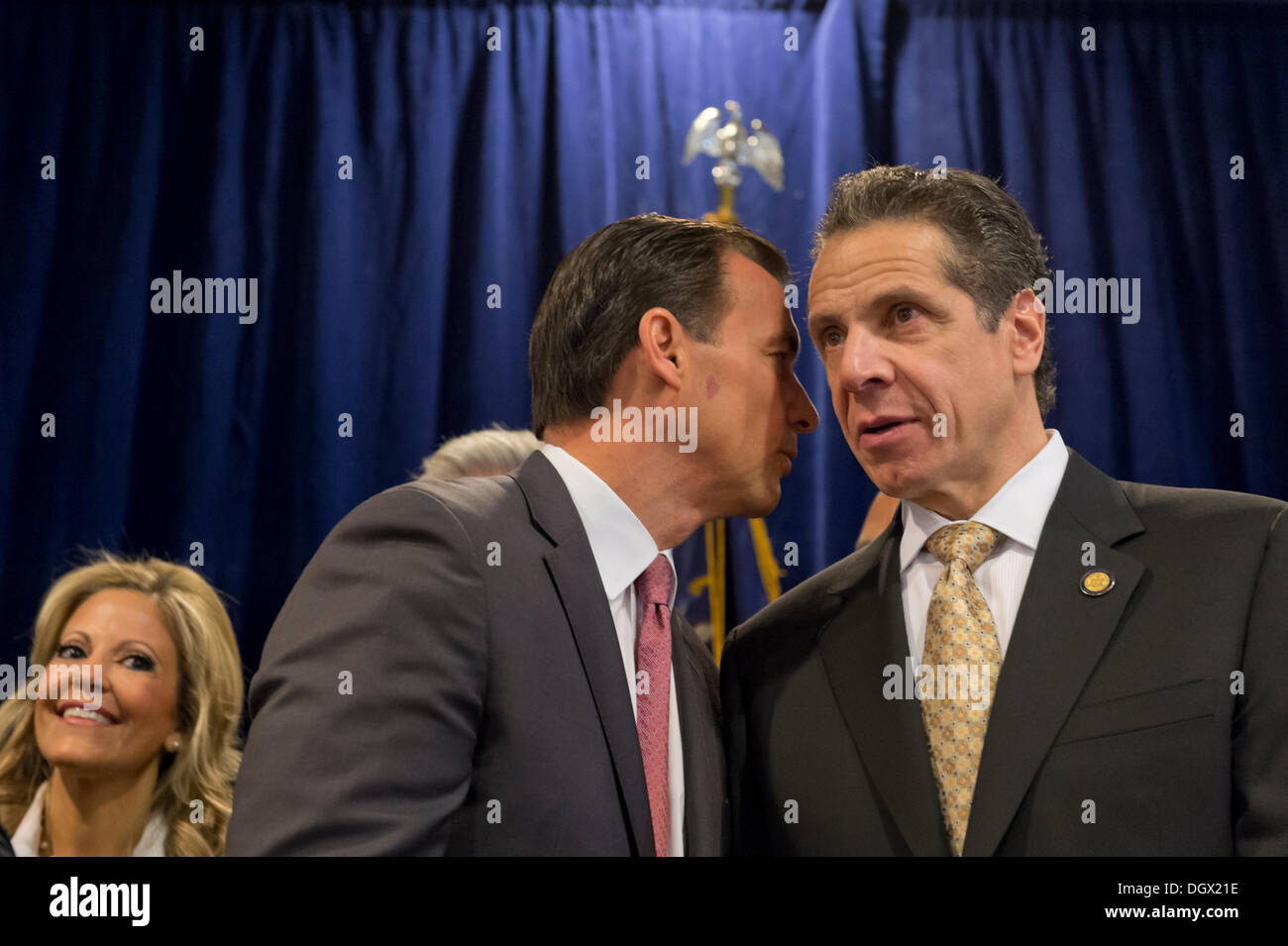 Albertson, New York, U.S. 26th October 2013. R-L, New York Governor ANDREW CUOMO , at right, endorses TOM SUOZZI, left of him, for Nassau County Executive, with supporters, including veterans, union members, and Democratic candidates for office in Nassau and Suffoilk Counties in Long Island, filling the announcement room at the Albertson Veterans of Foreign Wars VFW Post. Democrat Suozzi, the former Nassau County Executive, and Republican encumbant Mangano face each other in a rematch in the upcoming November 5th election. © Ann E Parry/Alamy Live News - Stock Image