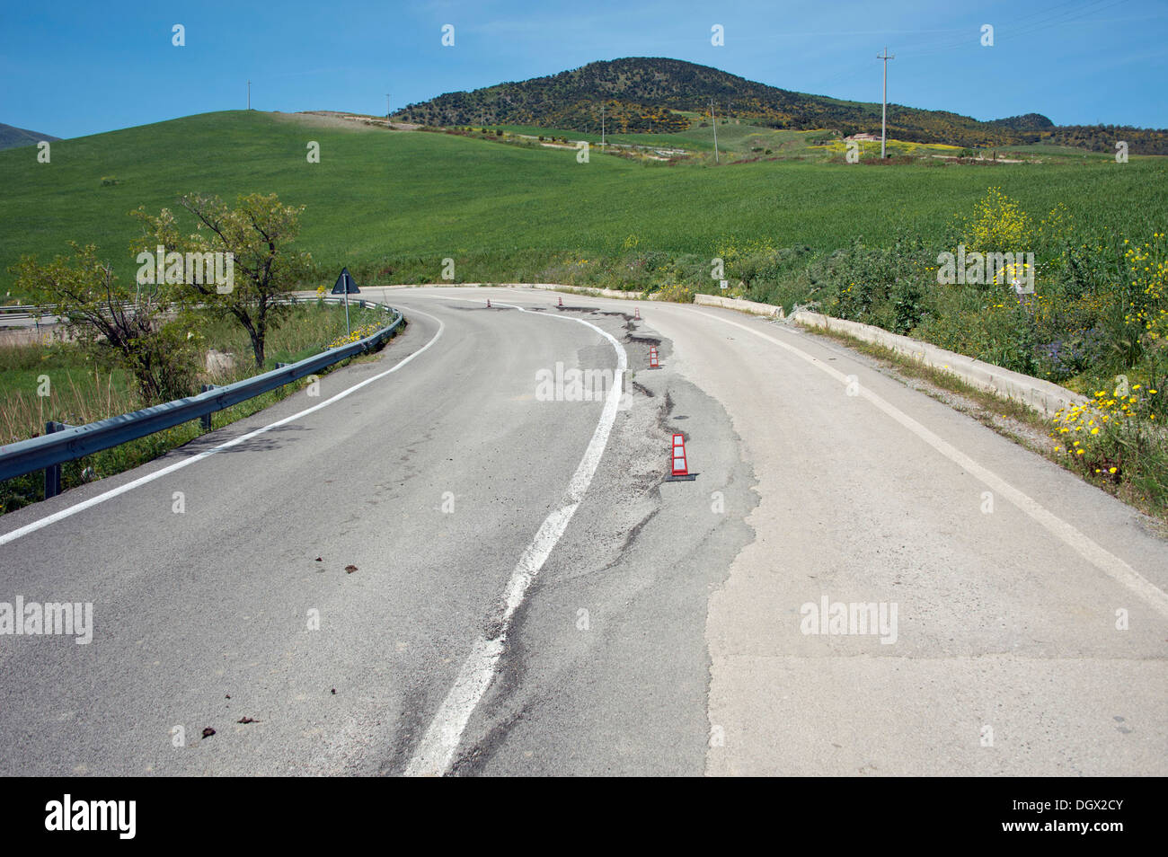 Road damaged by volcanic activity, Cerda, Sicily, Italy, Europe - Stock Image