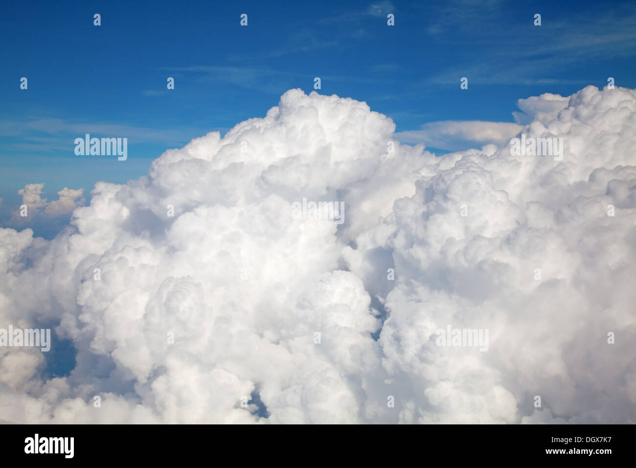 White fluffy clouds in blue sky - Stock Image