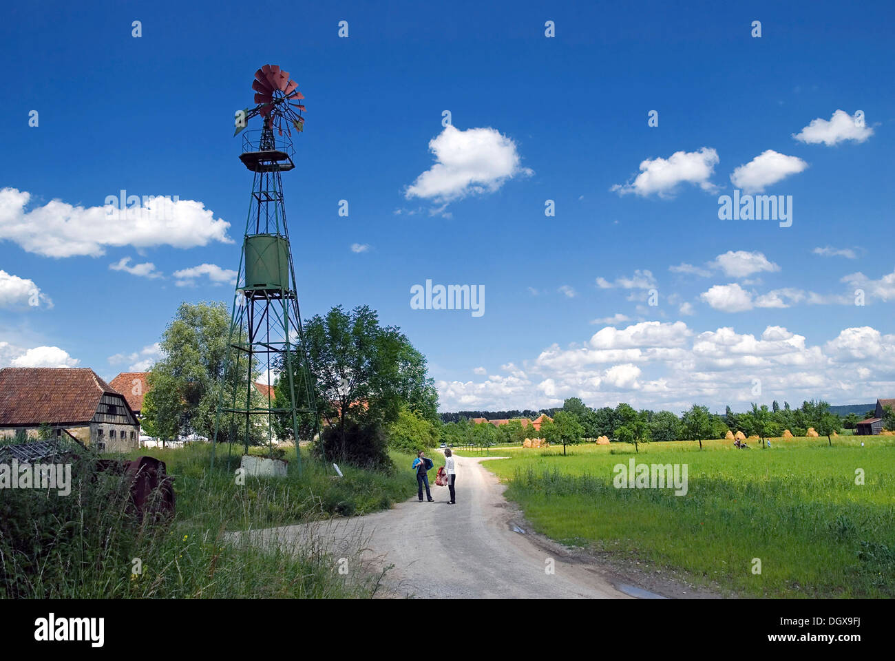 Old windmill for pumping water from Mainfranken, clouds in the sky, Franconian Open-air Museum of Bad Windsheim, Bavaria - Stock Image