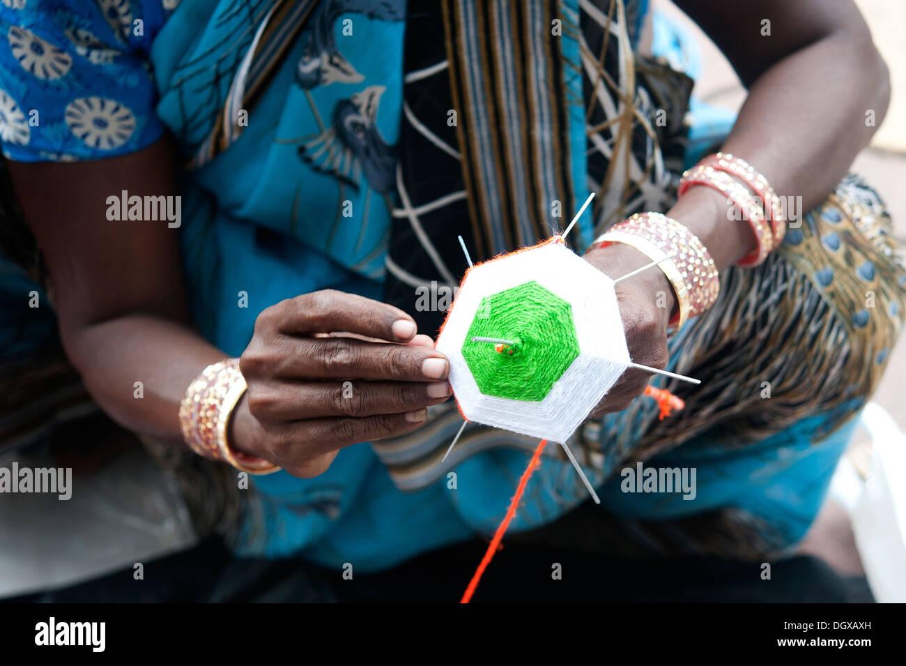 Woman hand crafting a miniature umbrella sporting Indian National Flag, Mumbai, India - Stock Image