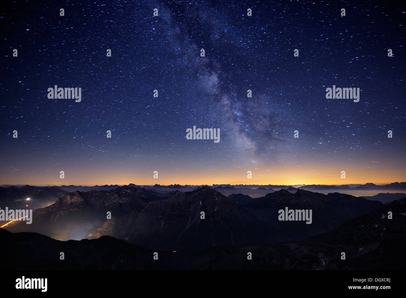 Mountains in the evening light with Milky Way and stars, Warth, Vorarlberg, Austria, Europe - Stock Image