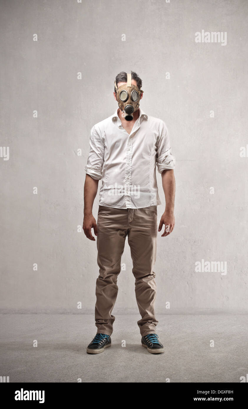 Guy standing with a gas mask - Stock Image