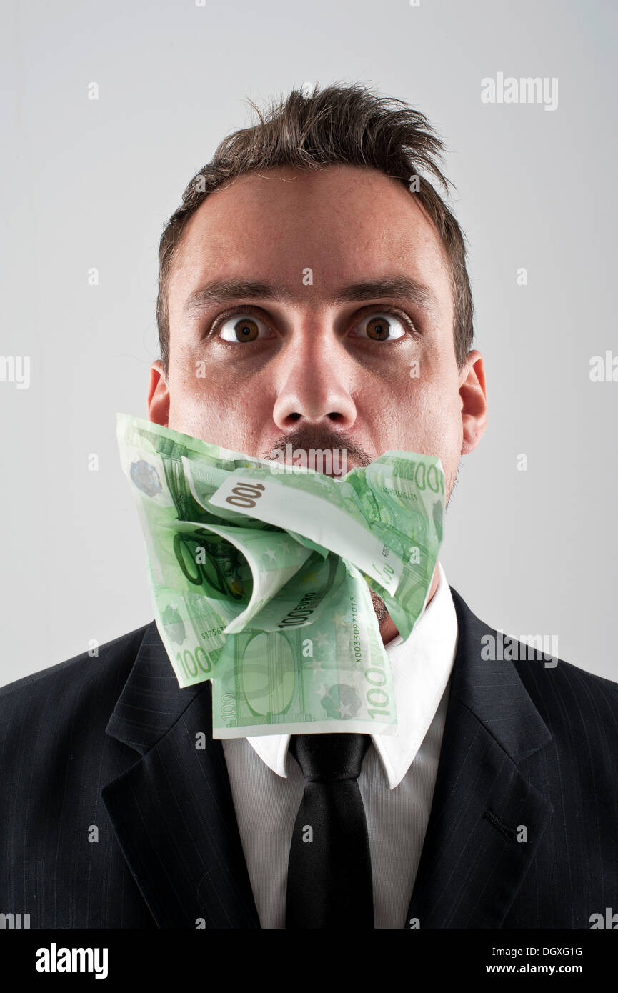 Guy in mask gets his mouth stuffed