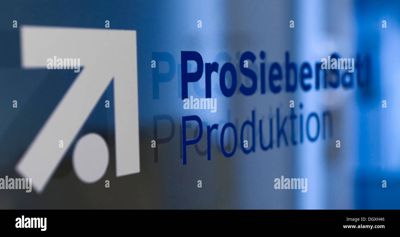 Logo of the ProSiebenSat.1 Media AG, lettering Produktion, Production, on a glass door in the broadcast center of ProSiebenSat.1 - Stock Image