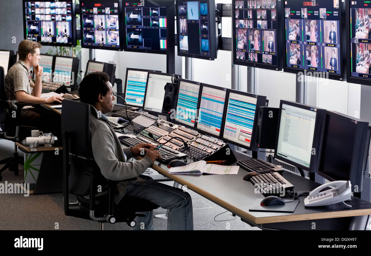 Technician at the Playout Center of ProSiebenSat.1 Media AG, where the network's program is being broadcasted, the program is - Stock Image