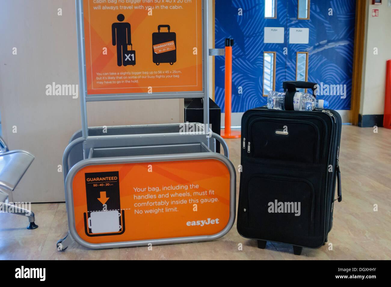 Suitcase Beside An Easyjet Bag Size Gauge Stock Photo