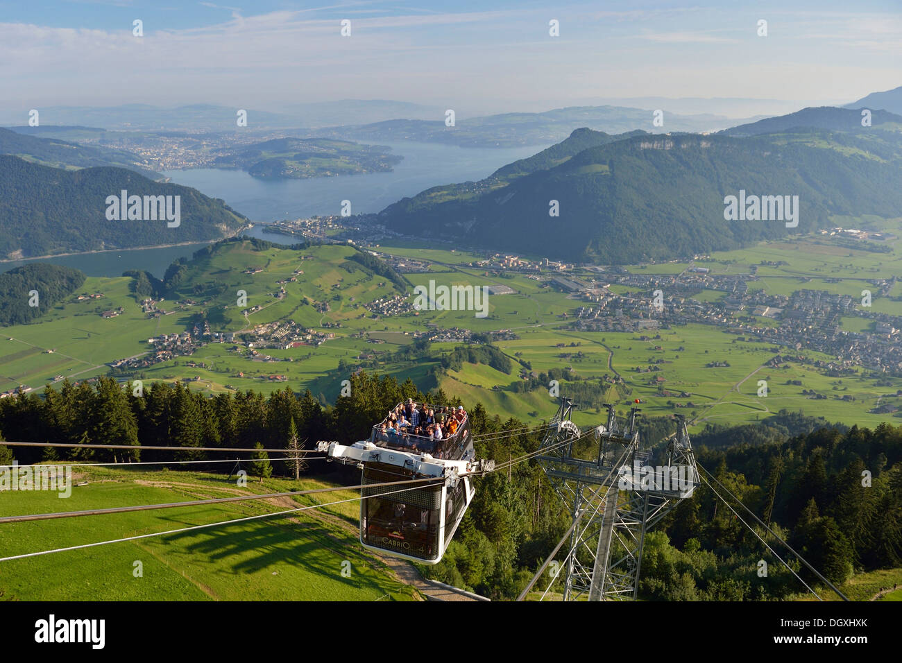 CabriO Bahn, the world's first cable car with an open top deck, going up Stanserhorn Mountain, Stans, Switzerland, Europe - Stock Image