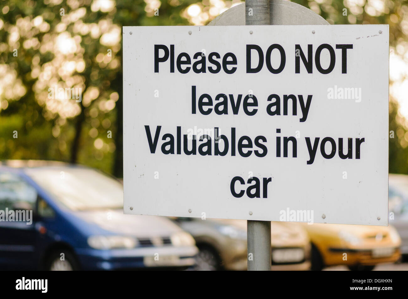 Sign in a car park warning drivers not to leave any valuables in their car - Stock Image