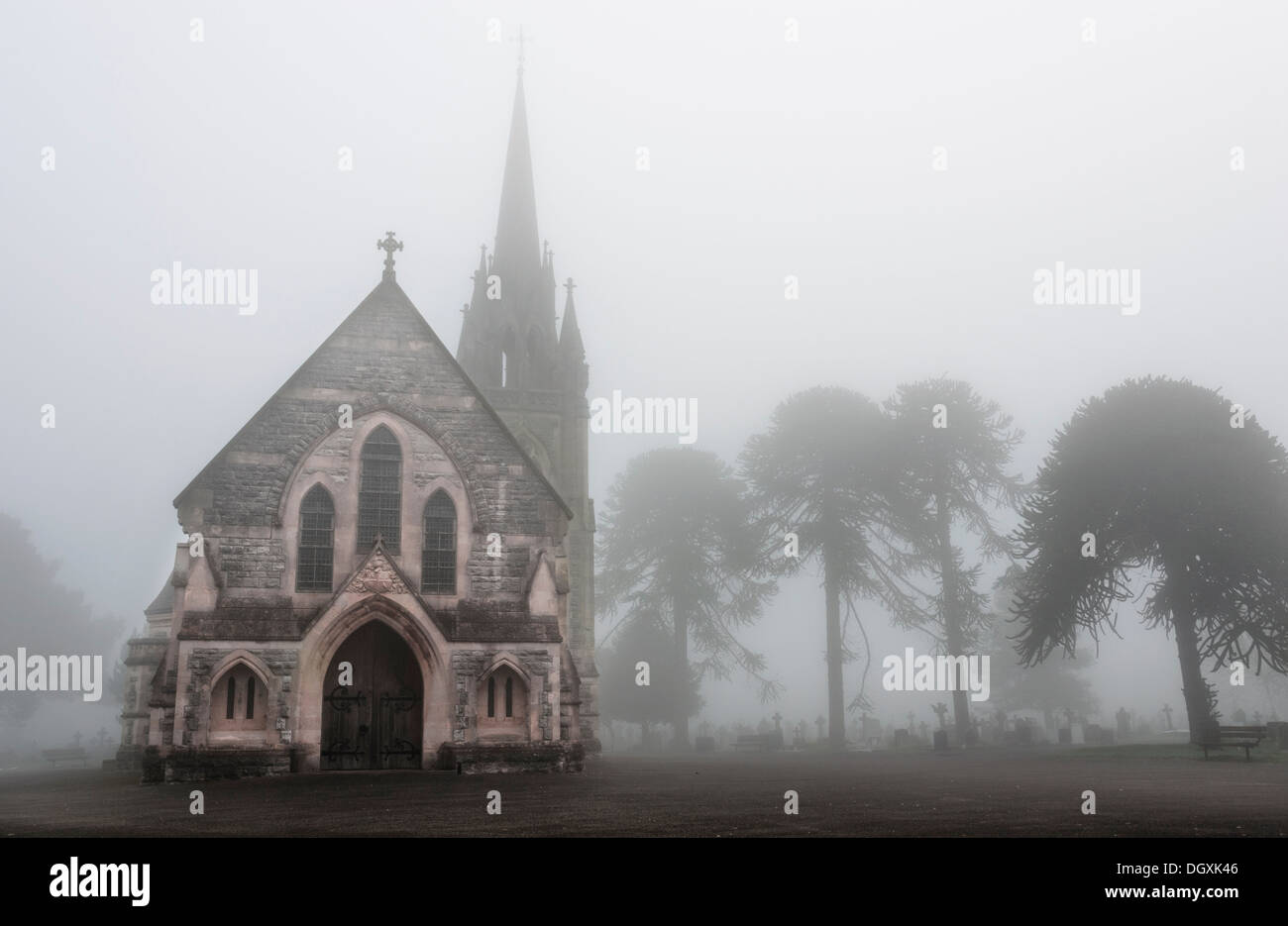 Old Church in a creepy foggy cemetery - Stock Image