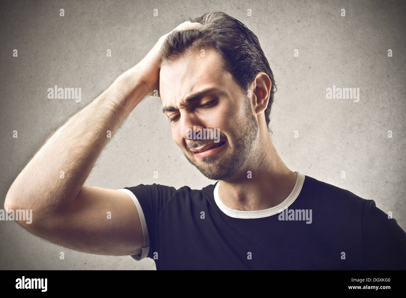 Portrait of a despairing boy - Stock Image