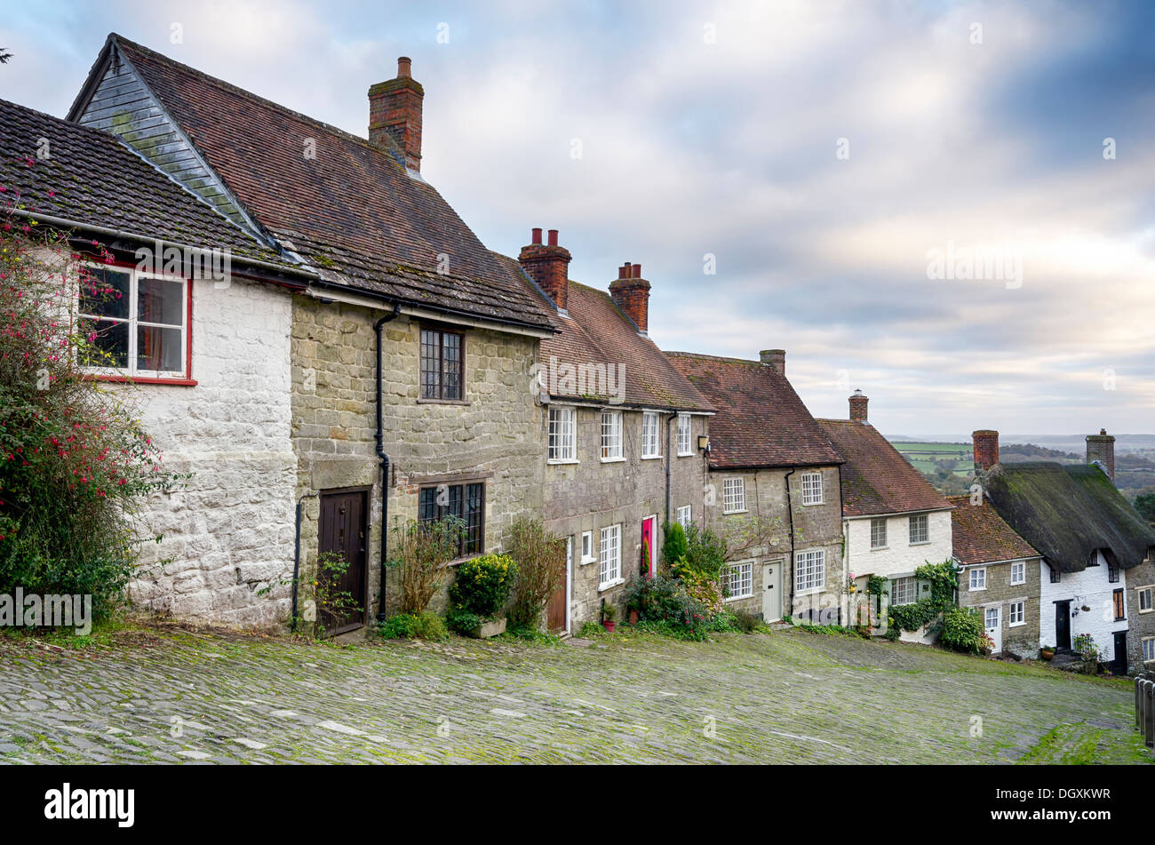Row of quaint English cottages at Gold Hill in Shaftesbury in Dorset. Stock Photo