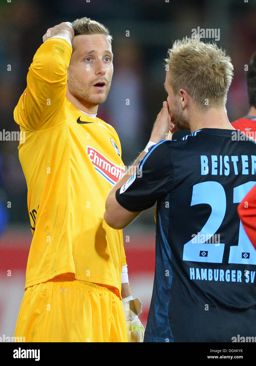 Freiburg, Germany. 27th Oct, 2013. Freiburg's goalkeeper Oliver Baumann (L) and Hamburg's Maximilian Beister (R) after the German Bundesliga soccer match between SC Freiburg and Hamburger SV at the Mage Solar Stadium in Freiburg, Germany, 27 October 2013. Photo: PATRICK SEEGER (ATTENTION: Due to the accreditation guidelines, the DFL only permits the publication and utilisation of up to 15 pictures per match on the internet and in online media during the match.)/dpa/Alamy Live News - Stock Image