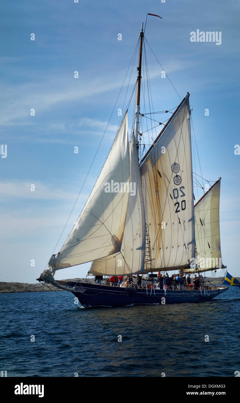 A double-gaff ketch sailing. - Stock Image