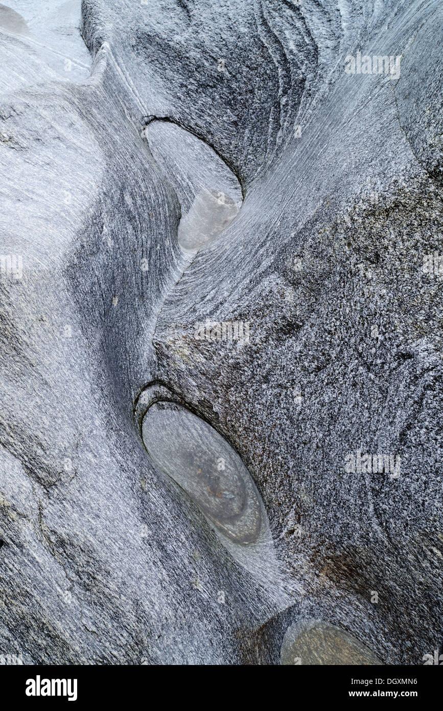 Natural stone formations ground by the Verzasca River, Lavertezzo, Locarno, Kanton Tessin, Switzerland - Stock Image