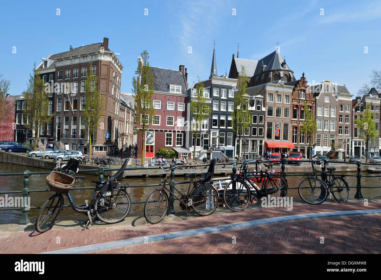 Historical merchants' houses on the Herengracht canal in the historic centre, several old bicycles at front, Amsterdam - Stock Image