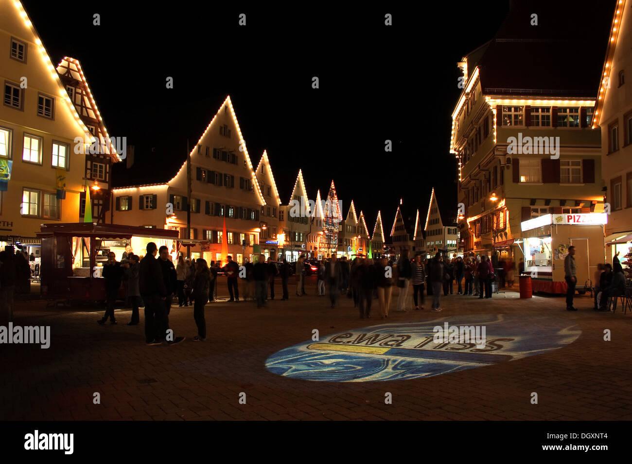 Spotlighted ground, ewa.riss electricity distributor advertising, market square, Biberach an der Riss, Upper Swabia - Stock Image