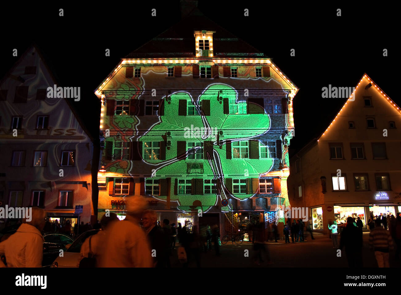Clover image projected on Kleeblatthaus building, market square, of Biberach an der Riss, light projection installation - Stock Image