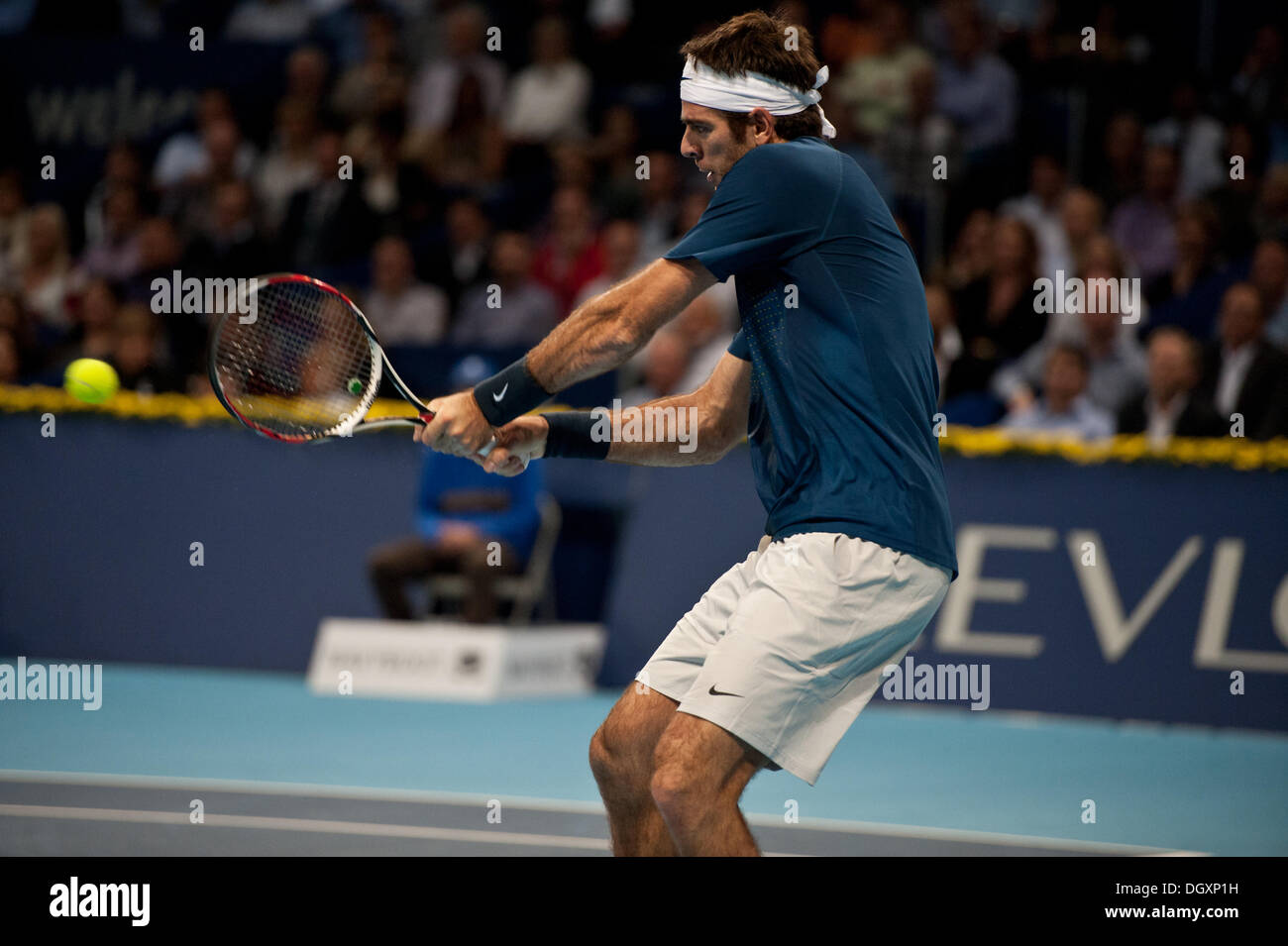 Basel, Switzerland. 27th Oct, 2013. J.M. Del Potro (ARG) hits the ball with a backhand during the final of the Swiss Indoors at St. Jakobshalle on Sunday. Photo: Miroslav Dakov/ Alamy Live News - Stock Image