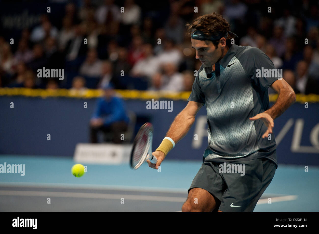 Basel, Switzerland. 27th Oct, 2013. Roger Federer (SUI) hits the ball during the final of the Swiss Indoors at St. Jakobshalle on Sunday. Photo: Miroslav Dakov/ Alamy Live News - Stock Image