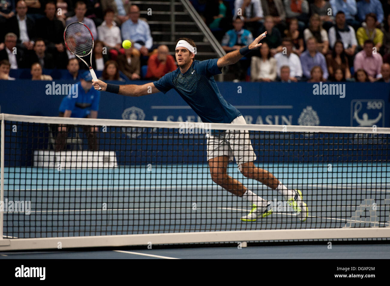 Basel, Switzerland. 27th Oct, 2013. J.M. Del Potro (ARG) reaches for the ball at the net during the final of the Swiss Indoors at St. Jakobshalle on Sunday. Photo: Miroslav Dakov/ Alamy Live News - Stock Image