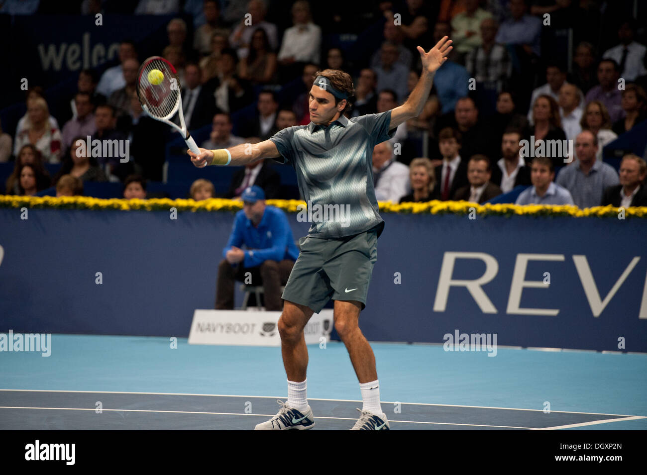 Basel, Switzerland. 27th Oct, 2013. Roger Federer (SUI) hits a volley during the final of the Swiss Indoors at St. Jakobshalle on Sunday. Photo: Miroslav Dakov/ Alamy Live News - Stock Image